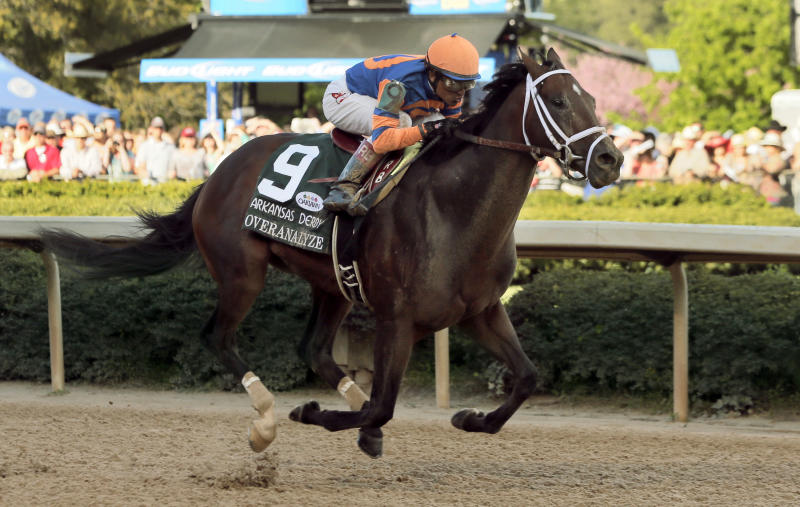 Overanalyze and jockey Rafael Bejarano approach the finish line to win the  $1 million Arkansas Derby horse race at Oaklawn Park in Hot Springs, Ark., Saturday, April 13, 2013. (AP Photo/Danny Johnston)