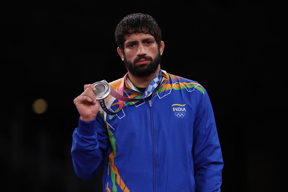 CHIBA, JAPAN - AUGUST 05: Men's Freestyle 57kg silver medalist Kumar Ravi of Team India poses with his medal during the Victory Ceremony on day thirteen of the Tokyo 2020 Olympic Games at Makuhari Messe Hall on August 05, 2021 in Chiba, Japan. (Photo by Maddie Meyer/Getty Images)