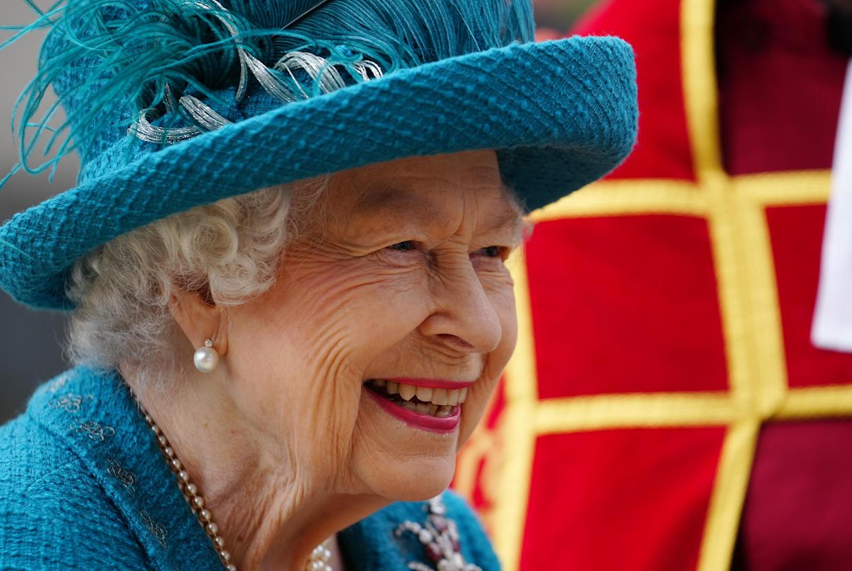 Queen Elizabeth II smiles during a visit to Manchester Cathedral to hear about the support they have given to the local community during the last 18 months. Picture date: Thursday July 8, 2021.