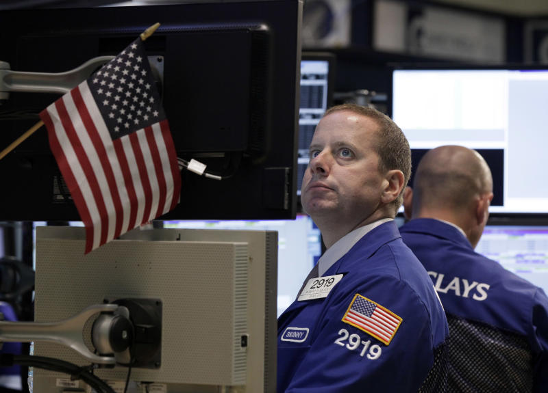Specialist Robert Nelson works on the floor of the New York Stock Exchange Thursday, July 26, 2012. The Dow Jones industrial average on Thursday jumped 212 points following big gains in European markets. (AP Photo/Richard Drew)