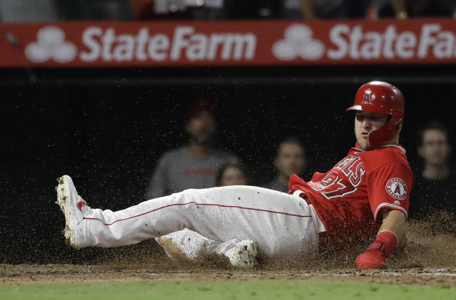 Los Angeles Angels' Mike Trout scores during the fifth inning of the team's baseball game against the Chicago White Sox on Thursday, Aug. 15, 2019, in Anaheim, Calif. (AP Photo/Marcio Jose Sanchez)