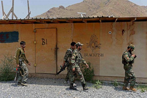 PHOTO: In this July 26, 2020, file photo, Afghan National Army (ANA) soldiers walk in a US military base, which has been recently handed over to Afghan forces in Achin district of Nangarhar province. (Noorullah Shirzada/AFP via Getty Images, FILE)