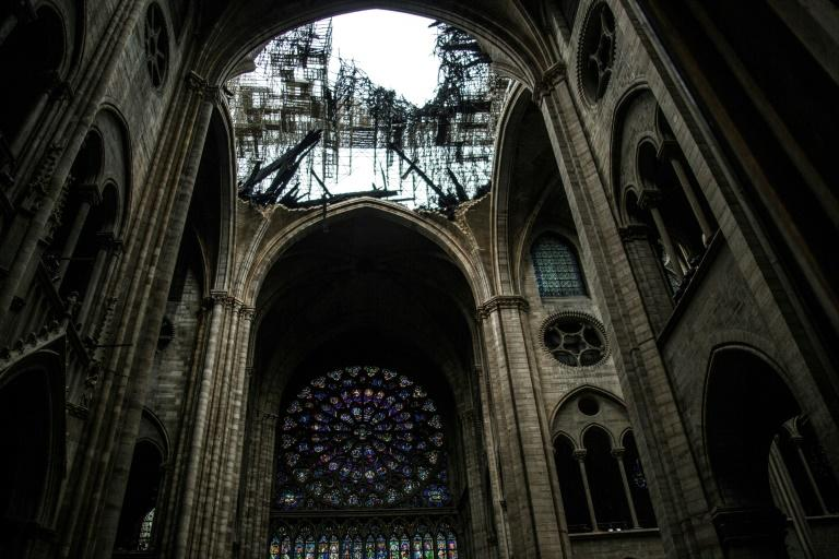 One of the rose windows below the damaged roof of Notre-Dame