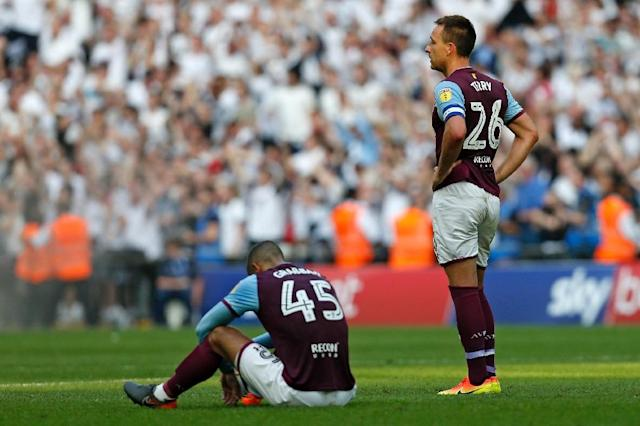 Aston Villa posted huge financial losses after defeat in last season's Championship play-off final to Fulham (AFP Photo/Ian KINGTON)