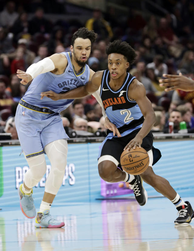 Cleveland Cavaliers' Collin Sexton (2) drives pat Memphis Grizzlies' Dillon Brooks (24) in the second half of an NBA basketball game, Friday, Dec. 20, 2019, in Cleveland. (AP Photo/Tony Dejak)