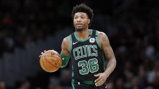 "<a class=""link rapid-noclick-resp"" href=""/nba/players/5317/"" data-ylk=""slk:Marcus Smart"">Marcus Smart</a> announced that he has joined a growing list of NBA players confirmed with COVID-19. (AP Photo/Michael Dwyer)"