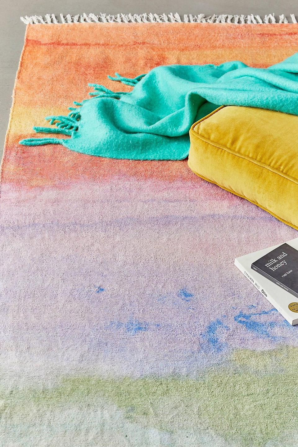 """<p>Add some color to your room with this <a href=""""https://www.popsugar.com/buy/Watercolor-Sunset-Chenille-Rug-546155?p_name=Watercolor%20Sunset%20Chenille%20Rug&retailer=urbanoutfitters.com&pid=546155&price=169&evar1=casa%3Aus&evar9=45186448&evar98=https%3A%2F%2Fwww.popsugar.com%2Fhome%2Fphoto-gallery%2F45186448%2Fimage%2F47349992%2FWatercolor-Sunset-Chenille-Rug&list1=shopping%2Curban%20outfitters%2Chome%20decor%2Csmall%20space%20living%2Cdecor%20shopping&prop13=mobile&pdata=1"""" class=""""link rapid-noclick-resp"""" rel=""""nofollow noopener"""" target=""""_blank"""" data-ylk=""""slk:Watercolor Sunset Chenille Rug"""">Watercolor Sunset Chenille Rug</a> ($169, originally $189).</p>"""