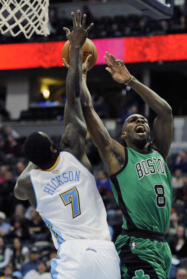 Boston Celtics forward Jeff Green, right, is fouled by Denver Nuggets forward J.J. Hickson in the first half of an NBA basketball game on Tuesday, Jan. 7, 2014, in Denver. (AP Photo/Chris Schneider)