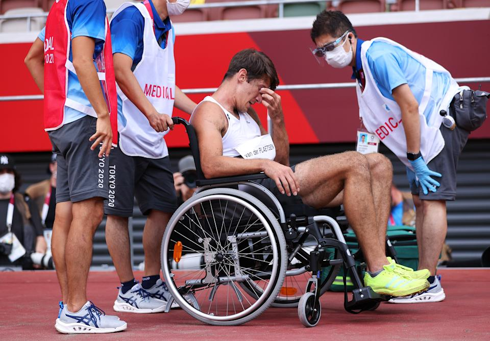 Medical staff attend to Thomas van der Plaetsen of Team Belgium at the Tokyo Olympics