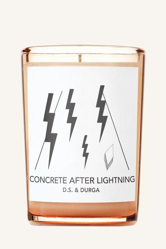"""<p><strong>D.S. & Durga</strong></p><p>dsanddurga.com</p><p><strong>$65.00</strong></p><p><a href=""""https://dsanddurga.com/collections/candles/products/concrete-after-lightning"""" rel=""""nofollow noopener"""" target=""""_blank"""" data-ylk=""""slk:Shop Now"""" class=""""link rapid-noclick-resp"""">Shop Now</a></p><p>""""While my favorite candles to hoard are those saint votives you can find at any grocery store in Brooklyn, my favorite <em>actual</em> candles come from <a href=""""https://dsanddurga.com/"""" rel=""""nofollow noopener"""" target=""""_blank"""" data-ylk=""""slk:D.S. & Durga"""" class=""""link rapid-noclick-resp"""">D.S. & Durga</a>. We know them for their perfumes of course, but they offer their scents as candles & car fragrances too! I love how thoughtfully they build out every scent, and create an entire sensory world around each (including playlists!) They also do flash tattoo days at their Soho store which I just think is the greatest–I got tatted with a storm cloud by <a href=""""https://www.instagram.com/minkasicklinger/?hl=en"""" rel=""""nofollow noopener"""" target=""""_blank"""" data-ylk=""""slk:Minka Sicklinger"""" class=""""link rapid-noclick-resp"""">Minka Sicklinger</a> after purchasing the <a href=""""https://dsanddurga.com/collections/candles/products/concrete-after-lightning"""" rel=""""nofollow noopener"""" target=""""_blank"""" data-ylk=""""slk:Concrete After Lightning"""" class=""""link rapid-noclick-resp"""">Concrete After Lightning</a> candle. It just felt right!""""—<em>Rosie Jarman, fashion assistant</em></p>"""