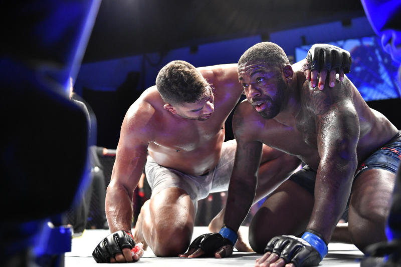 JACKSONVILLE, FLORIDA - MAY 16: Alistair Overeem (L) of Great Britain consuls Walt Harris of the United States after their Heavyweight bout during UFC Fight Night at VyStar Veterans Memorial Arena on May 16, 2020 in Jacksonville, Florida. (Photo by Douglas P. DeFelice/Getty Images)