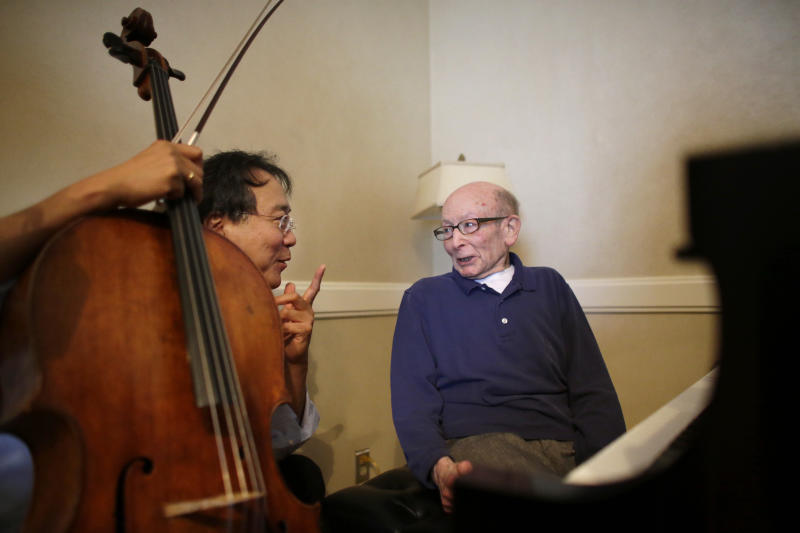 Cellist Yo-Yo Ma, left, rehearses with Holocaust survivor George Horner at Symphony Hall Tuesday afternoon, Oct. 22, 2013, in Boston. The 90-year-old pianist will make his orchestral debut with Ma Tuesday night, where they will play music composed 70 years ago at the Nazi prison camp where Horner was imprisoned. (AP Photo/Steven Senne)