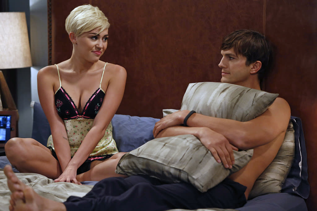 Yikes! We heard that Miley's character, flirty new girl in town Missi, was a love interest for Jake. But from the looks of this photo, she's got her eye on Walden (Ashton Kutcher). At least the always-modest Walden shields his bare chest with a pillow. Quick thinking, Walden.
