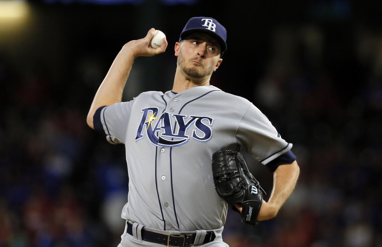 FILE - In this Saturday, Oct. 1, 2016, file photo, Tampa Bay Rays starting pitcher Jake Odorizzi (23) throws to the Texas Rangers in the first inning of a baseball game in Arlington, Texas. Odorizzi of Tampa Bay and Michael Wacha of St. Louis have gone to salary arbitration and are among six first-time eligible starting pitchers who could get decisions Tuesday, Feb. 14, 2017. (AP Photo/Tony Gutierrez, File)