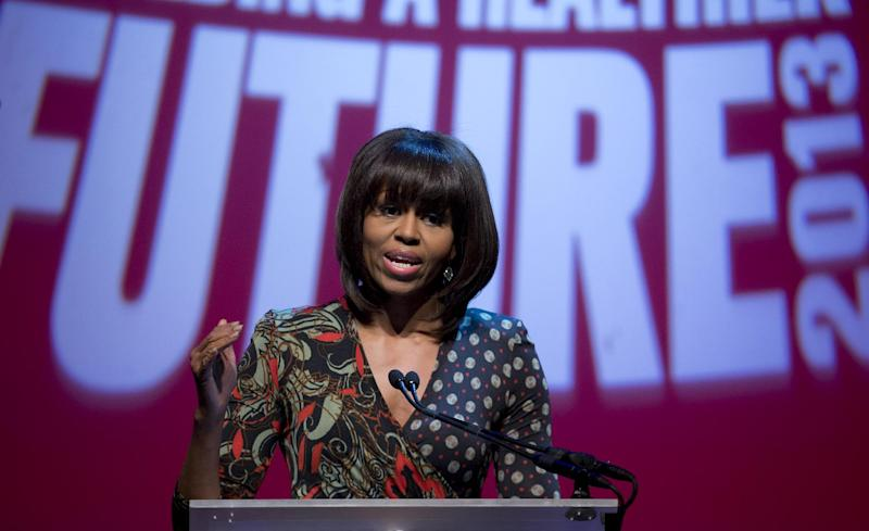 First lady Michelle Obama speaks at the Partnership for a Healthier America's second Building a Healthier Future Summit on childhood obesity, Friday, March 8, 2013, at George Washington University's Lisner Auditorium in Washington. (AP Photo/Carolyn Kaster)