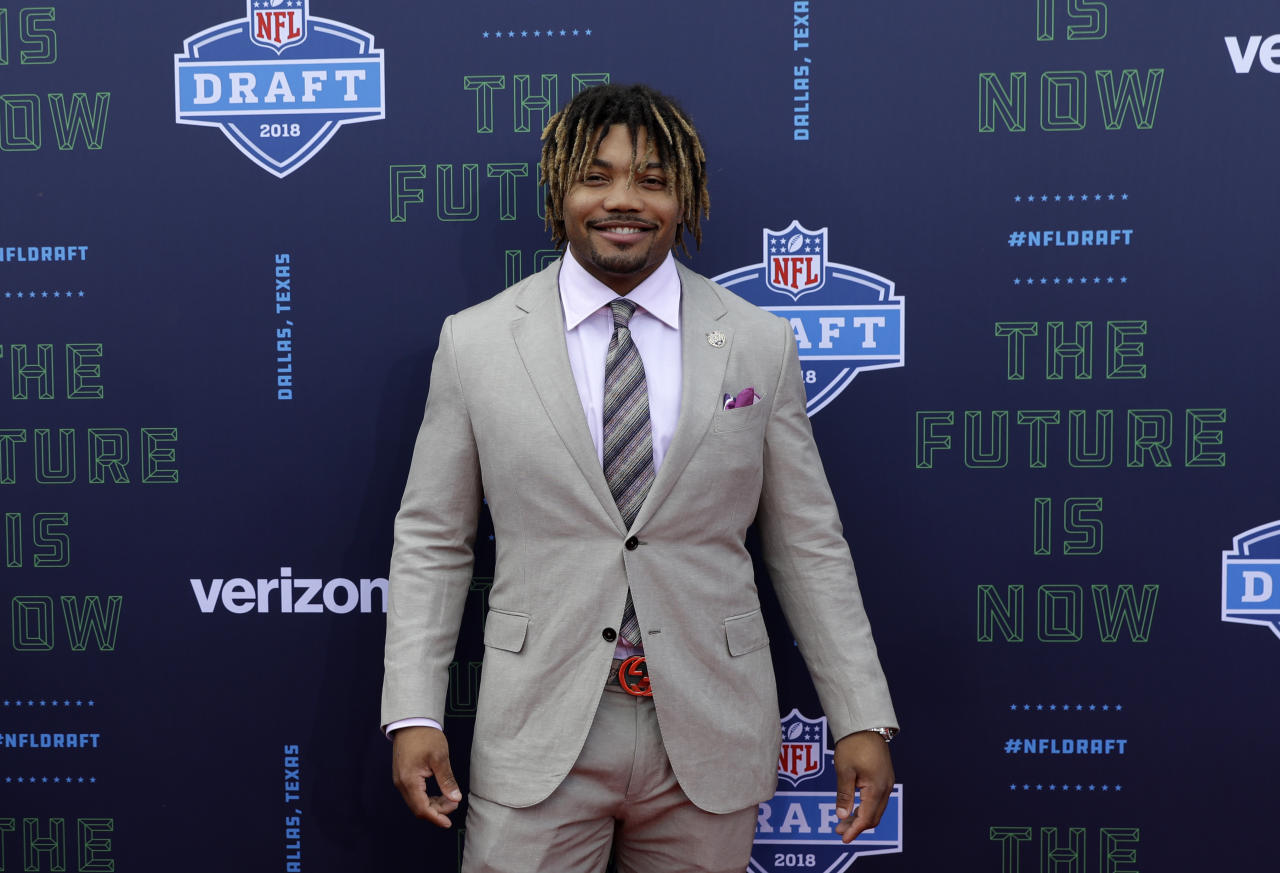 <p>LSU's Derrius Guice poses for photos on the red carpet during the first round of the 2018 NFL football draft, Thursday, April 26, 2018, in Arlington, Texas. (AP Photo/Eric Gay) </p>