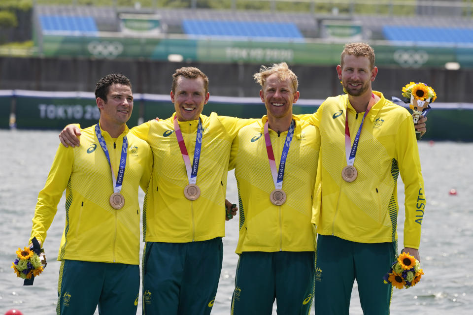 Jack Cleary, Caleb Antill, Cameron Girdlestone and Luke Letcher, of Australia, pose with the bronze medal following the men's rowing quadruple sculls final at the 2020 Summer Olympics, Wednesday, July 28, 2021, in Tokyo, Japan. (AP Photo/Darron Cummings)