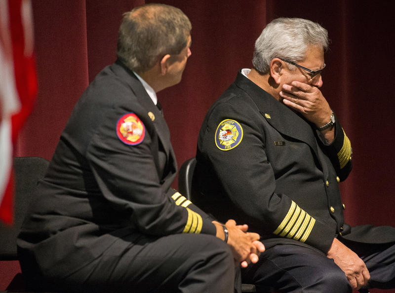 Dan Fraijo, Prescott Fire Chief, right, and Darrell Willis , Prescott Fire Department Woodland Division Chief , listen to a video during a press conference at Prescott High School Saturday Sept. 28, 2013, addressing the public and the media on their findings involving the Yarnell Hill Fire and the death of 19 Granite Mountain Hot Shots. (AP Photo /The Arizona Republic, Tom Tingle)