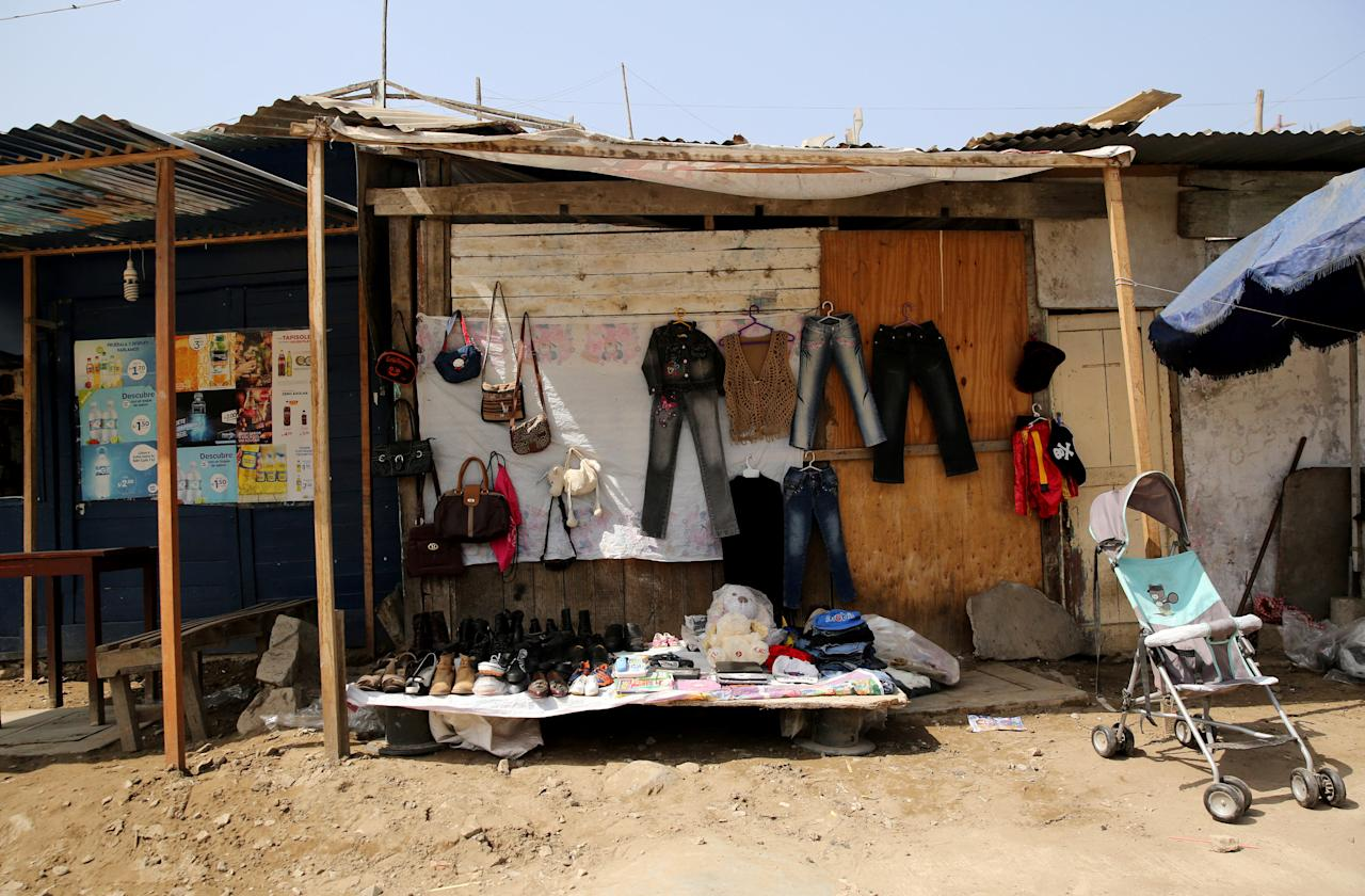 Used clothes and other items are displayed for sale at a street in Pamplona Alta shanty town in the San Juan de Miraflores district of Lima, Peru, June 21, 2017. REUTERS/Mariana Bazo