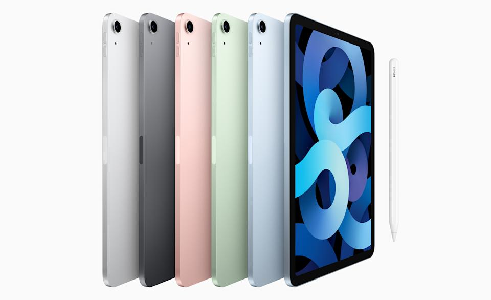 Six Apple iPad Air tablets all lined up showing the variety of color options.