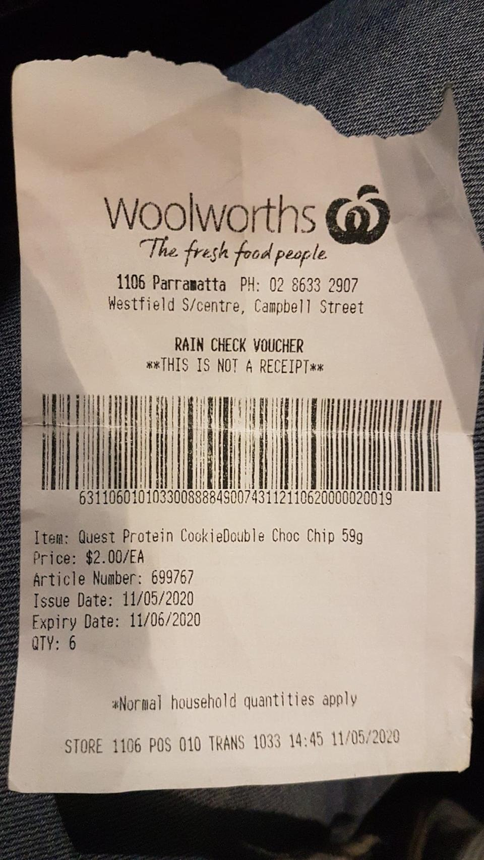 A rain check voucher is pictured from Woolworths for $12 worth of protein bars.