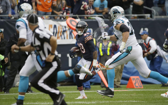 Chicago Bears safety Eddie Jackson (39) is chased by Carolina Panthers quarterback Cam Newton, left, and offensive tackle Matt Kalil after intercepting a pass by Newton for a 76-yard touchdown. (AP)