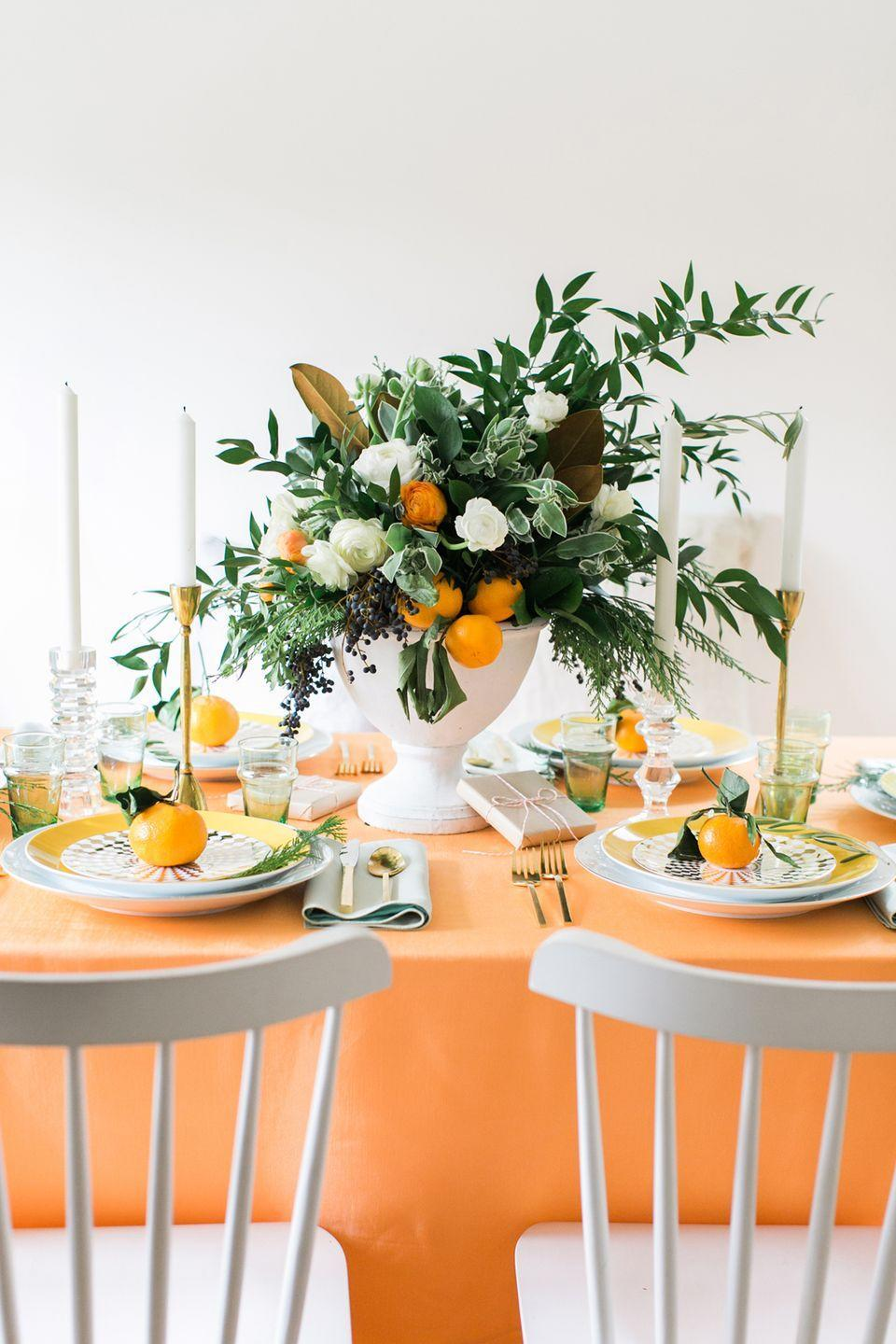 "<p>Pair the typical Thanksgiving color (in a more vibrant shade) with white for a clean and colorful table. Then, accent with fresh greens. They'll pop even more against the bright palette. </p><p>See more at <a href=""http://www.cocokelley.com/2016/12/holiday-tabletop-citrus-christmas/"" rel=""nofollow noopener"" target=""_blank"" data-ylk=""slk:Coco Kelley"" class=""link rapid-noclick-resp"">Coco Kelley</a>.<br></p>"