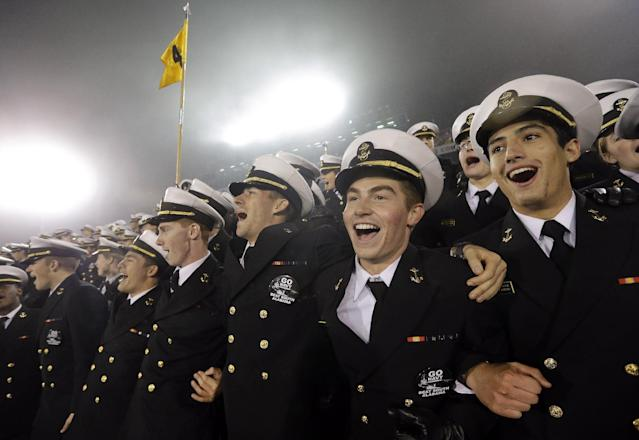 U.S. Naval Academy midshipmen celebrate in the final seconds of an NCAA college football game against South Alabama in Annapolis, Md., Saturday, Nov. 16, 2013. Navy won 42-14. (AP Photo/Patrick Semansky)