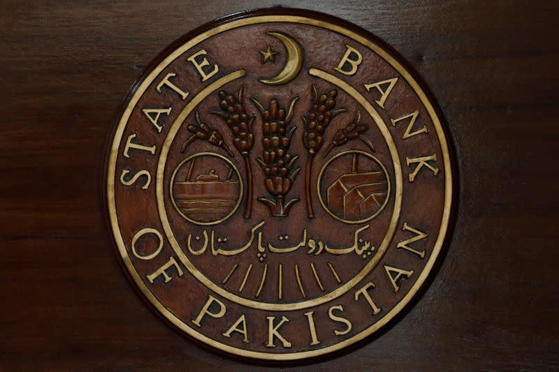 FILE PHOTO: A logo of the State Bank of Pakistan (SBP) is pictured on a reception desk at the head office in Karachi