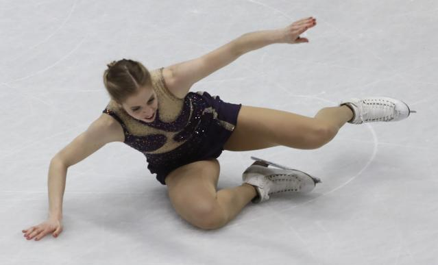 Carolina Kostner of Italy falls during the women's free skating program, at the Figure Skating World Championships in Assago, near Milan, Italy, Friday, March 23, 2018. (AP Photo/Luca Bruno)