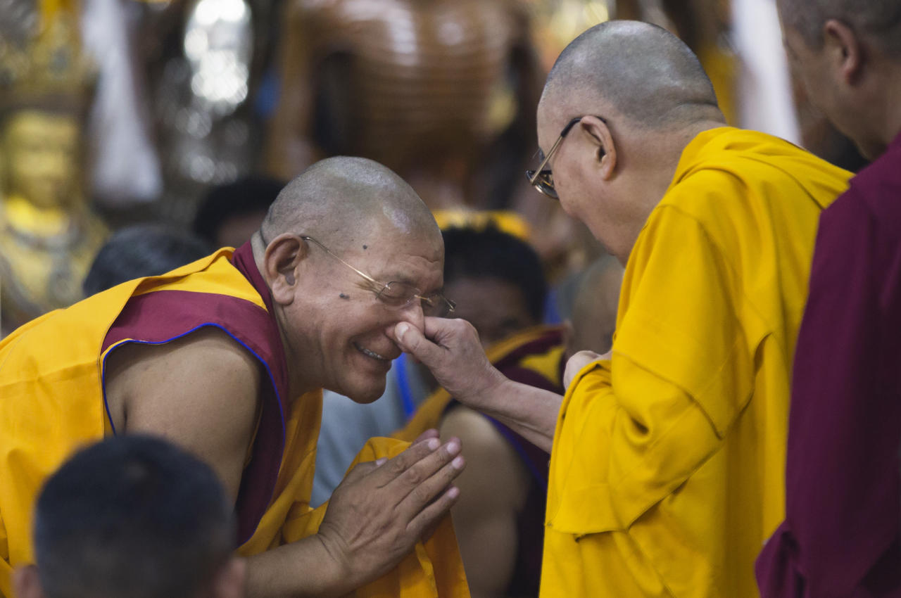<p>Tibetan spiritual leader the Dalai Lama playfully pinches the nose of a senior monk as he arrives to give a talk to Tibetan youth in Dharmsala, India, Thursday, June 7, 2018. Every year the Tibetan leader speaks to young Tibetans to introduce them to Buddhist precepts. (AP Photo/Ashwini Bhatia) </p>