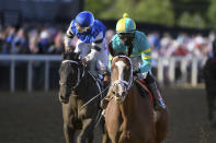 Joel Rosario, right, atop Army Wife crosses the finish line ahead of Ricardo Santana Jr. atop Willful Woman to win the Black-Eyed Susan Stakes horse race at Pimlico Race Course, Friday, May 14, 2021, in Baltimore. (AP Photo/Will Newton)