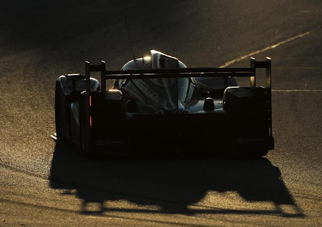 Nick Heidfeld, of Germany, drives his Rebellion Racing Lola B12/60 Toyota car during the American Le Mans Series' Petit Le Mans auto race at Road Atlanta, Saturday, Oct. 19, 2013, in Braselton, Ga. (AP Photo/Rainier Ehrhardt)