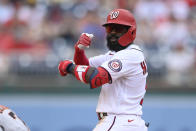Washington Nationals' Josh Harrison gestures at second base after he hit a double during the fifth inning of a baseball game against the San Francisco Giants, Sunday, June 13, 2021, in Washington. (AP Photo/Nick Wass)