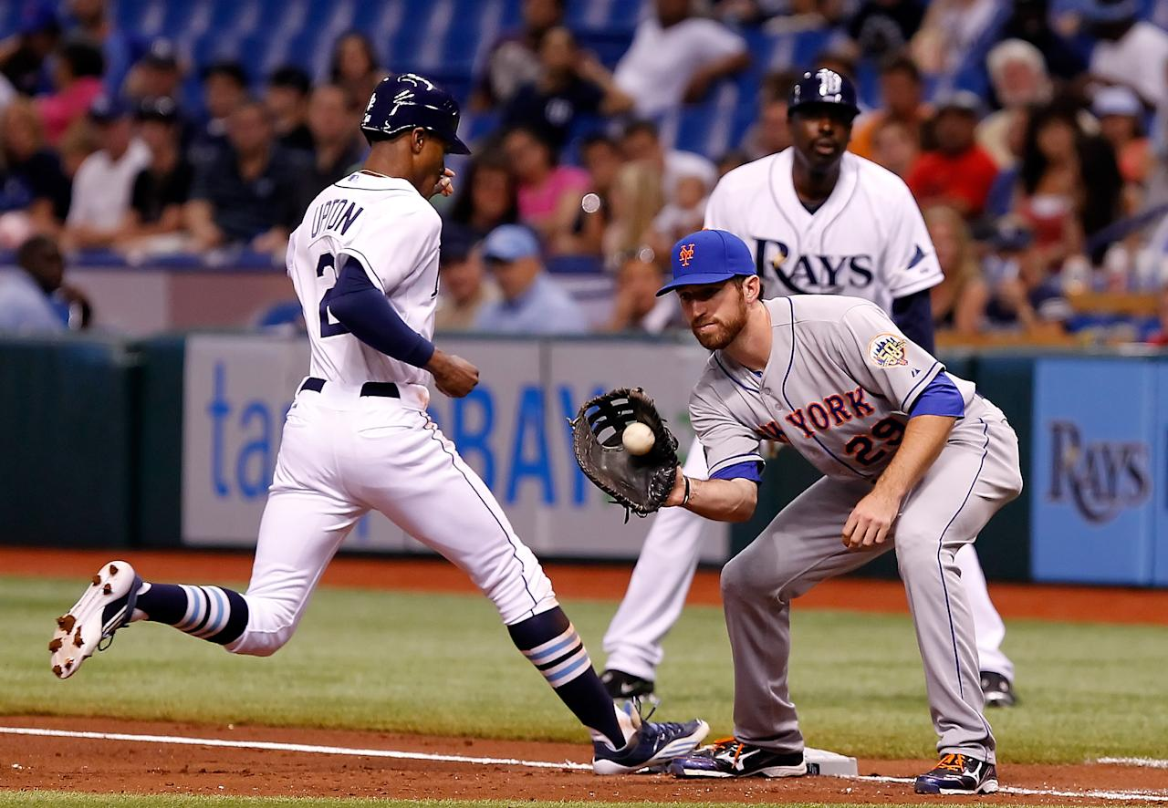 ST. PETERSBURG - JUNE 13:  First baseman Ike Davis #29 of the New York Mets takes the throw at first as outfielder B.J. Upton #2 of the Tampa Bay Rays gets back safely during the game at Tropicana Field on June 13, 2012 in St. Petersburg, Florida.  (Photo by J. Meric/Getty Images)