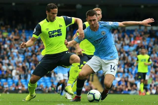 Egyptian Ramadan Sobhy (L) playing for Huddersfield Town against Manchester City last year (AFP Photo/Lindsey PARNABY)