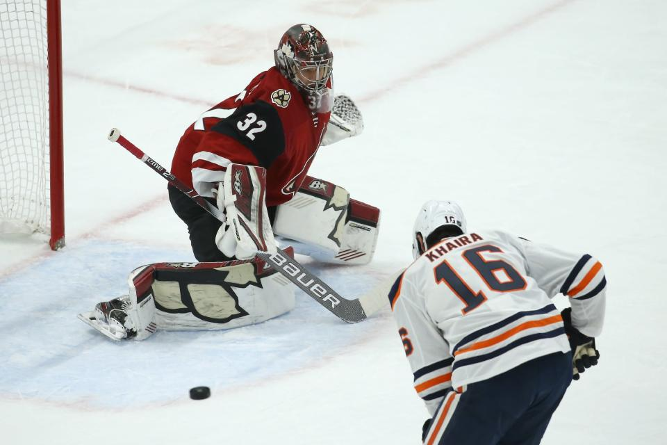 Edmonton Oilers left wing Jujhar Khaira (16) is unable to get to a pass as Arizona Coyotes goaltender Antti Raanta (32) slides over to protect the net during the first period of an NHL hockey game Tuesday, Feb. 4, 2020, in Glendale, Ariz. (AP Photo/Ross D. Franklin)