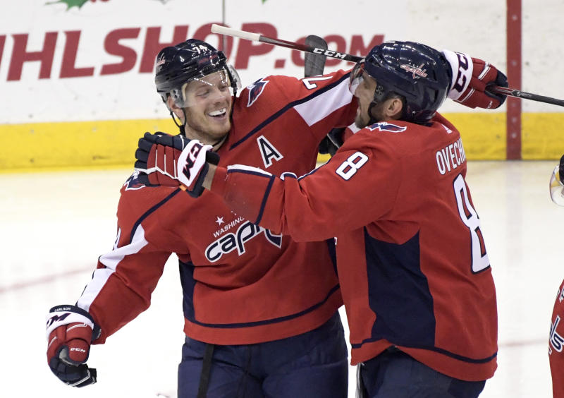 Washington Capitals defenseman John Carlson (74) celebrates his goal with left wing Alex Ovechkin (8) during the third period of an NHL hockey game against the New Jersey Devils, Friday, Dec. 20, 2019, in Newark, N.J. (AP Photo/Bill Kostroun)