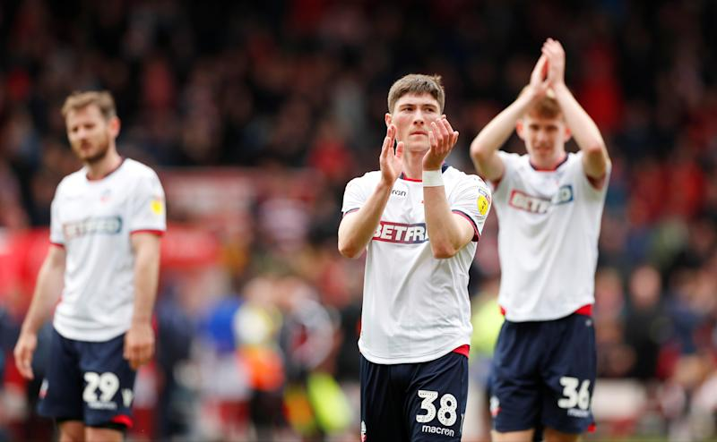 "Soccer Football - Championship - Nottingham Forest v Bolton Wanderers - The City Ground, Nottingham, Britain - May 5, 2019 Bolton Wanderers' Jack Earing and team mates applaud the fans at the end of the match Action Images/Peter Cziborra EDITORIAL USE ONLY. No use with unauthorized audio, video, data, fixture lists, club/league logos or ""live"" services. Online in-match use limited to 75 images, no video emulation. No use in betting, games or single club/league/player publications. Please contact your account representative for further details."