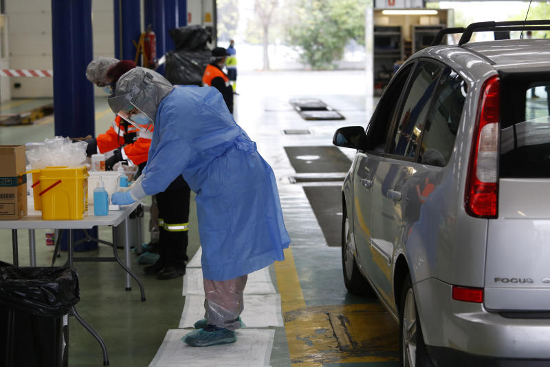 GRANADA, SPAIN - MARCH 26: A sanitarian is seen conducting a coronavirus test to health workers and Security Forces officers at an office of the service of the Technical Inspection of Vehicles on March 26, 2020 in Granada, Spain. (Photo by Álex Cámara/Europa Press via Getty Images)
