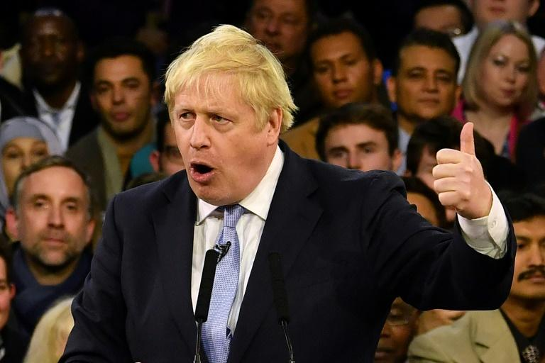 Britain's Prime Minister and Conservative party leader Boris Johnson speaks during a general election campaign rally in East London on the final day of campaigning for the general election