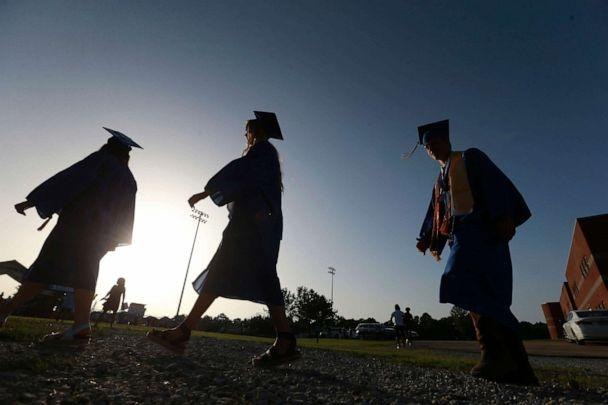 PHOTO: In this file photo taken on June 27, 2020, Saltillo High School seniors make their way to the football field as the sun begins to set for their graduation ceremony in Saltillo, Mississippi. (Thomas Wells/AP)