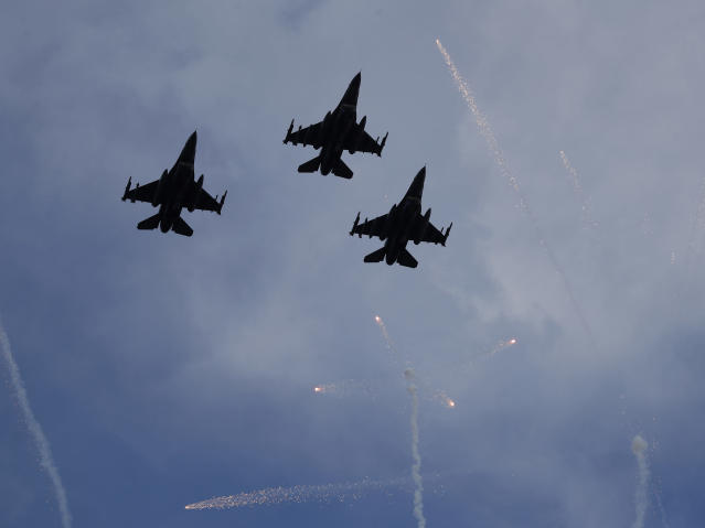 U.S. military jets fly over fireworks during Independence Day festivities before a baseball game between the Philadelphia Phillies and the Atlanta Braves on Thursday, July 4, 2019, in Atlanta. (AP Photo/John Bazemore)