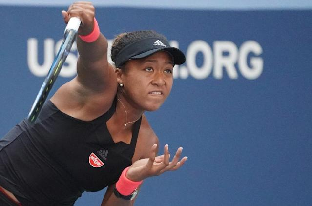 History-maker: Naomi Osaka serves on her way to victory over Lesia Tsurenko and a place in the US Open semi-finals (AFP Photo/TIMOTHY A. CLARY)