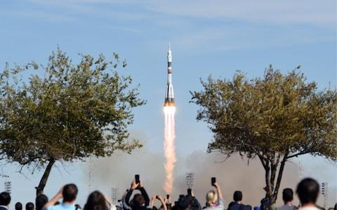 Soyuz-FG rocket booster blasts off from the Baikonur Cosmodrome carrying the Soyuz MS-10 spacecraft with Roscosmos cosmonaut Alexei Ovchinin and NASA astronaut Nick Hague of the ISS Expedition 57/58 prime crew aboard to the International Space Station (ISS) - Credit: Donat Sorokin/TASS