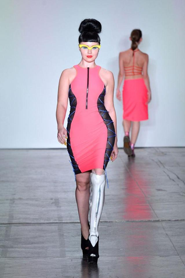 <p>Amputee model wears a pink and black scuba dress for Chromat's Fall 2018 show. (Photo: Getty) </p>