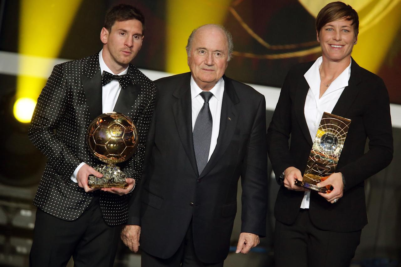 ZURICH, SWITZERLAND - JANUARY 07:  Lionel Messi of Argentina receives the FIFA Ballon d'Or 2012 trophy and Abby Wambach of United States receives her FIFA womens player of the year trophy by Joseph Blatter, FIFA president (C)  during the FIFA Ballon d'Or Gala 2013 at Congress House on January 07, 2013 in Zurich, Switzerland.  (Photo by Christof Koepsel/Getty Images)