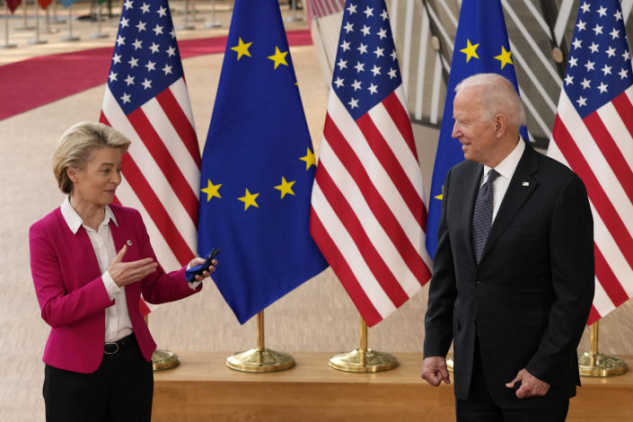 European Commission President Ursula von der Leyen, left, speaks with U.S. President Joe Biden during arrival for the EU-US summit at the European Council building in Brussels, Tuesday, June 15, 2021. (AP Photo/Francisco Seco)