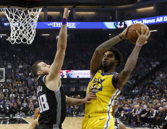 Golden State Warriors forward Marquese Chriss, right, goes to the basket against Sacramento Kings forward Nemanja Bjelica during the first quarter of an NBA basketball game in Sacramento, Calif., Monday, Jan. 6, 2020. (AP Photo/Rich Pedroncelli)