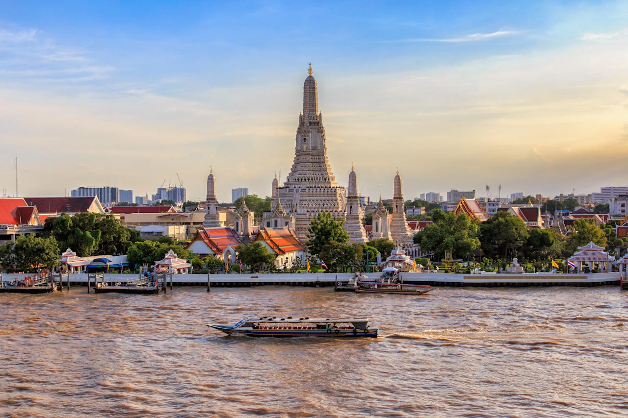 <p><strong>What's the story behind this temple?</strong><br> Of the more than 31,000 temples, or <em>wats</em>, throughout Thailand, Wat Arun is one of the most iconic. The 269-foot-tall prahng, a Khmer-style tower, juts out from the banks of the Chao Phraya River, and the temple complex is illuminated in a golden glow at night.</p> <p><strong>How easy is it to navigate? Do we need a guide?</strong><br> It's fine to fly solo at Wat Arun. There isn't much information available at the ticket booth, so let Google be your tour guide.</p> <p><strong>Why are people drawn to this space?</strong><br> Visitors clamor here because it's one of the few temples in Thailand that you can climb; once you've ascended the steep and narrow stairs, you're in for a great view of the river and surrounding temple complex. After taking in the sights, walk back down the stairs and inspect the floral murals made from broken Chinese porcelain discarded by Chinese traders who worked at the nearby port. Next, don't miss the <em>boht</em>—ordination hall—filled with the ashes of Rama II, more ornate murals, and rows of gilded Buddhas.</p> <p><strong>Please tell us it doesn't disappoint.</strong><br> This is a must-visit for anyone in Bangkok, and the temple lives up to the hype. The 3 baht—less than a penny!—boat ride from the Tien Pier across the river to the temple completes the experience.</p> <p><strong>Is there anyone Wat Arun you'd especially recommend this to?</strong><br> Although Bangkok doesn't have a reputation for being particularly child-friendly, parents will find plenty to like in the relaxed nature of a visit to Wat Arun, and little ones can explore freely.</p>